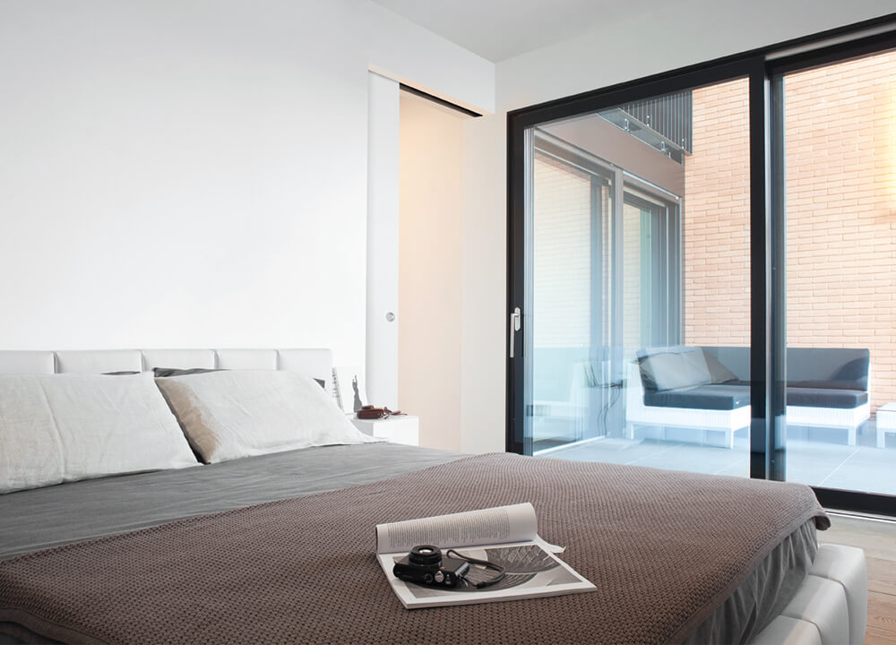 ECLISSE sliding pocket door system with no jambs nor architraves